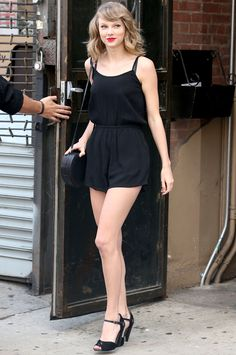It's no question that Taylor Swift is a street style pro—the star consistently steps out in winning retro-inspired ensembles, with her latest being no exception. We loved her playful black romper so much, we found out exactly where to buy it!