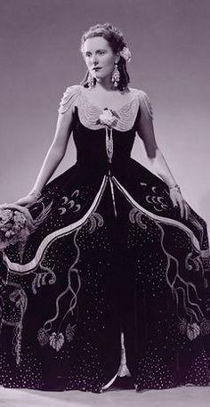 "Costume dress from opera ""La Traviata"" with full skirt & draped pearl cap sleeves."