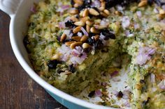 Spinach Rice Gratin - A delicious rice gratin recipe - a hearty casserole of baked rice flecked with spinach. The top bakes into a golden cheese crust made even better with a generous sprinkling of black olives, red onions, and toasted pine nuts.  - from 101Cookbooks.com