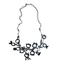 Shades of Black Ring Necklace, 2015 - Liana Pattihis -Shades of Black Ring Necklace, 2015 'Layer upon layer the enamel encapsulates the rings, obscuring 'the treasure beneath'. Suspended, trapped or rendered immobile, the rings not unlike the ones 'offered', become mere ornaments, an inseparable part of the chains that hold them together'. Silver Trace Chain, Copper Wire, Enamel. L89cm