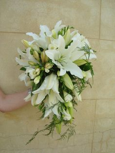 teardrop bouquet of lillies, freesia and soft greenery created by Sweet Floral