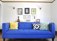 bright blue couch with yellow and green pillows