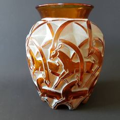 Rene lalique Chamois vase in amber glass highlighted with enamel designed in 1932