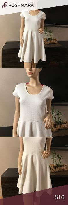 WHITE SHORT SLEEVE SKATER DRESS Beautiful white skater dress, has little make up stain on the last picture which is washable.  Body 95% Polyester 5% Spandex Planet Gold Dresses Mini