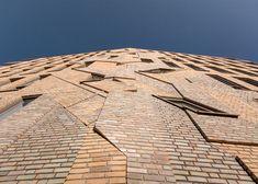 Former graffiti artist Boris Tellegen created brick artwork for this Haarlem complex designed by Heren 5 Architects