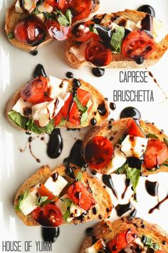 Caprese Bruschetta.  Flavorful tomatoes, basil, and fresh mozzarella with a balsamic reduction drizzle.