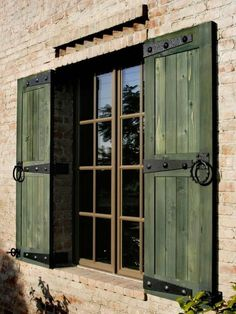 fantastic wooden shutters in green color