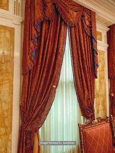 Lot 692 - A pair of gold and burgundy curtains supplied by Jacquard from Rudolph Ackermann`s A series design