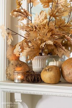 Fall Mantel With Muted Classic Colors - Sincerely, Marie Designs Fall is here and we're thrilled! I'm sharing our fall mantel with classic colors. I hope that it inspires you to bring a little fall into your home too! Apartment Decoration, Decoration Bedroom, Room Decor, Autumn Nature, Autumn Home, Autumn Mantel, Fall Mantels, Christmas Mantles, Fireplace Mantels