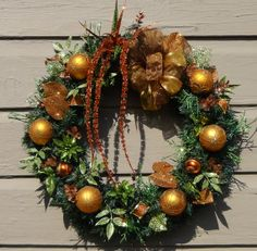 Bronze Christmas Pine Wreath of gold ornaments, clover, glittered green, sheer bronze bow  22x21x7