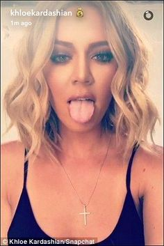 Doing a Miley! Khloe stuck her tongue out for her selfie videos and pictures as she tried ...