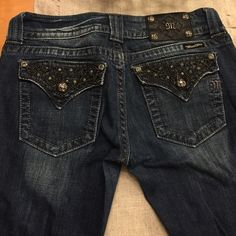 Miss Me Jeans Great condition Miss Me Jeans. Dark blue and all jewels attached. Some of the chains on the back are hanging,can't remember if they are suppose to be that way. Size 29 regular length. Miss Me Jeans Boot Cut