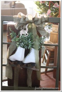 vintage window decorated with old ice skates and greenery
