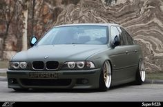 bmw e39 - from china - now wrapped in army green foil.