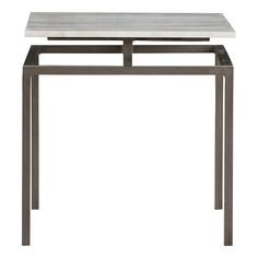 """Indigo Side Table H: 18.5"""" W: 18"""" D: 18"""" Hidden supports on the Indigo Table create a floating effect of the white marble top. Natural iron framing form the square base of this table. We love how it looks different based on your perspective. Every marble piece will vary slightly."""