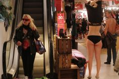 MEETING THE REQUIREMENT: People in their underwear searched for clothes in Paris on Wednesday. Spanish fashion brand Desigual started a sale in by offering the first 100 customers clothes for free as long as they showed up dressed in only their underwear. (Christian Hartmann/Reuters)