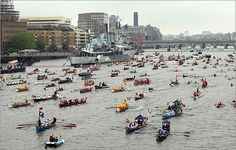 The man powered section of the pageant passed HMS Belfast in London on June 3. Hundreds of rowing boats, barges and steamers filled the River Thames with a blaze of color as Queen Elizabeth II sailed through London as part of her diamond jubilee.