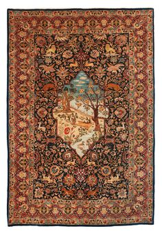 SEMI-ANTIQUE TABRIZ FIGURAL. 216,5 x 145 cm. A dark green ground with polychrome deer, predators, palmette and flower festoons as well as a medallion with a landscape with a running deer and a swimming duck. A red main border with arabesque and palmette vines.