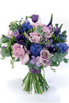 Roses, hyacinth, freesia, lisianthus, veronica, eucalyptus and bear grass from weddingmagazine.co.uk