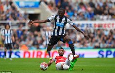 Mbemba, the defender signed from Anderlecht this summer for £8.5m, skips over the challeng...