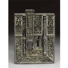 A RARE AND FINE CHEST LOCK, SPANISH, 16TH CENTURY wrought iron, the finely worked clasp with an angel within an architectural niche, with cut out tracery all over, the bolts in the form of Gothic pilasters on Solomonic columns, the lower corners with scallop shells, (possibly for St James of Compostella), lacking keyhole guard