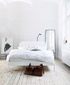 white bedroom. love the floor