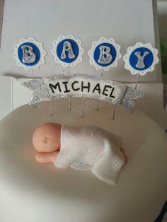 Baby Boy Shower Cake with Baby Fondant - Green velvet piñata cake wit MnM's and strawberry buttercream