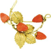 Coral, Gold Brooch. The brooch features carved coral |