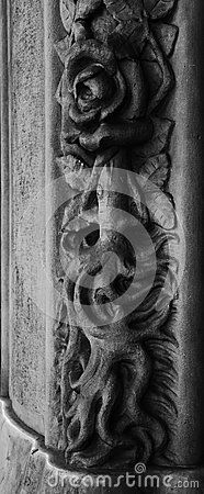 Shot in black and white, detail of an sculpture representing a rose with roots tower,  in the facade  of an historic building, set in Eixample, Barcelona, Catalunya, Catalonia, España, Spain, Europe, Europa