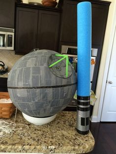 Home made Death Star Piñata for a cool Star Wars birthday party. Lots of pics to show you how to DIY it yourself