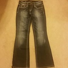 Rerock Express Size 0 Short Jeans Boot Cut Pre-loved Rerock Express Size 0S Boot Cut Jeans.  Great condition except a little signs of wear on the bottom of pant legs.  Let me know if you have any questions and thanks for looking!  :) Express Jeans Boot Cut