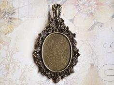 Eine hochwertige bronzefarbene Cabochon Fassung mit Verschluss    Farbe: Bronze