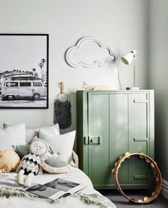 The norsuHOME - Harvey's Bedroom   Photographer: Lisa Cohen Stylist: Beck Simon  Paint: Dulux Spanish Olive Carpet: Godfrey Hirst  Door: Corinthian Doors  Products:  HK Living cabinet, Surf Bus Print, Donna Delaney Cactus Print, Electric Confetti Cloud neon light, Amigos De Hoy Tambourine, Honey Honey Wall hanging, Felix Furniture Side Table (all available at www.norsu.com.au)