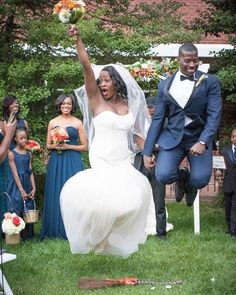 Now this is how you jump the broom! Fun photo by  @photographybytracie. More of this Baltimore wedding on the blog now! #munaluchibride #munaluchi #wedding #jumpingthebroom #love #blacklove
