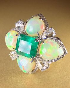 Bodacious emerald, opal, and diamond ring by @sutrajewels