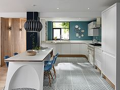Our very popular Remo Kitchen is shown here in Matt White, paired with fab #patternedtiles for that #retro look