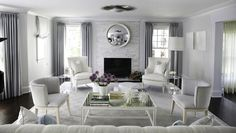 Morgan Harrison Home: Chic, contemporary living room with sunburst flush-mount light and floor to ceiling blue ...