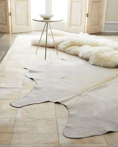 Layering With Cowhides Patchwork Cowhide And Sheepskin Rug Want The Same For Your Home