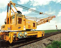A railroad crane, (US: crane car or wrecker; UK: breakdown crane) is a type of crane used on a railroad for one of three primary uses: freight handling in goods yards, permanent way (PW) maintenance, and accident recovery work. Boeing Ch 47 Chinook, Crane Car, Work Train, Railroad Pictures, Milwaukee Road, Railroad Photography, Train Pictures, Heavy Machinery, Rolling Stock