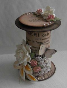 Made from a toilet paper roll! (Idk what on Earth this would be used for...shabby chic wedding decor? pretty, though!)