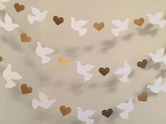 Here is a beautiful Dove and heart garland for your next special occasion! Perfect for a Wedding , Christening - Baptism-1st Holy Communion- Baby Dedication-or Confirmation. Even lovely for Easter! This beautiful 10 foot paper garland is made with 3.5 inch card stock doves and