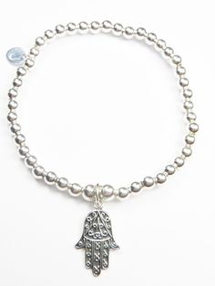 Sterling silver 4mm bead bracelet with lovely hamsa hand charm