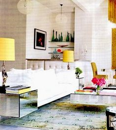 I just had to share this room from Living Etc. that I spotted on This is Glamorous' fabulous post on lucite. It is the living room next to this fabulous dining room I can see peeking out in the background.