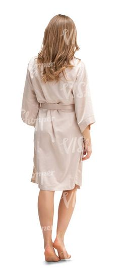 cut out woman in a beige silky bathrobe walking