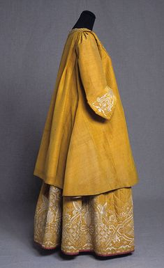 Adrienne and Quilted Petticoat worn as wedding ensemble. Dress, silk, linen, embroidery, quilting, 1740-50, KM 77.976