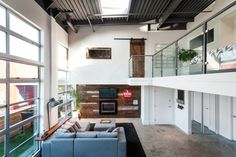 Apartments › Vintage Modern Double-Height Loft in Vancouver Creatively Designed by TheMACNABS  Read more: http://freshome.com/2014/11/28/vintage-modern-double-height-loft-in-vancouver-creatively-designed-by-themacnabs/#ixzz3KOT7b6nA
