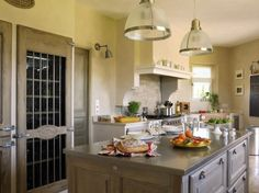 Cuisine Poivre d'Ane  French kitchen Love the pantry doors