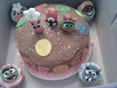 Yo Gabba Gabba cake and cupcakes. Characters made from fondant.