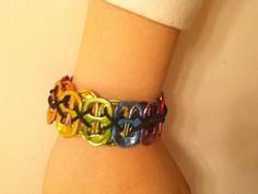 """This is my latest creation! My fun bracelet is made from soda pop tabs. I used alcohol inks and stretch cord to transform this """"junk"""" into stylish jewelry! They're super easy to make and fun for kids to wear."""
