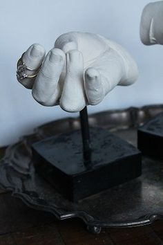 Make plaster casts of you hand with wax molds.